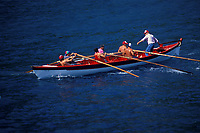 team rows traditional open whale boat, or canoa, during race, Pico Island, Azores, Portugal (North Atlantic Ocean)