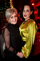 """HOLLYWOOD - FEBRUARY 20: Sharon Osbourne and Dita Von Teese attend Ozzy Osbourne global tattoo and album listening party to celebrate his new album """"Ordinary Man"""" on February 20, 2020 in Hollywood, California. (Photo by Lionel Hahn/Epic Records/PictureGroup)"""