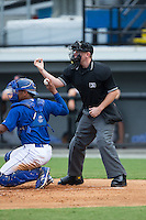 Home plate umpire Russell Weich makes a strike call during the Appalachian League game between the Danville Braves and the Burlington Royals at Burlington Athletic Park on July 12, 2015 in Burlington, North Carolina.  The Royals defeated the Braves 9-3. (Brian Westerholt/Four Seam Images)