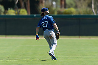 Los Angeles Dodgers outfielder Andrew Shaps (27) warms up between innings of an Instructional League game against the Oakland Athletics at Camelback Ranch on September 27, 2018 in Glendale, Arizona. (Zachary Lucy/Four Seam Images)