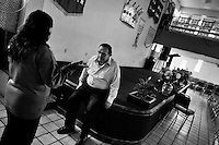Pastor Hugo Alvarez talks to a woman after the exorcism ritual at the Church of the Divine Saviour in Mexico City, Mexico, 31 May 2011. Exorcism is an ancient religious technique of evicting spirits, generally called demons or evil, from a person which is believed to be possessed. Although the formal catholic rite of exorcism is rarely seen and must be only conducted by a designated priest, there are many Christian pastors and preachers (known as 'exorcistas') performing exorcism and prayers of liberation. Using their strong charisma, special skills and religous formulas, they command the evil spirit to depart a victim's mind and body, usually invoking Jesus Christ or God to intervene in favour of a possessed person.