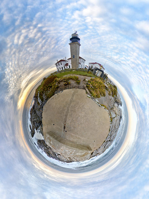 A unique aerial view of Beavertail Lighthouse and the surrounding horizon.
