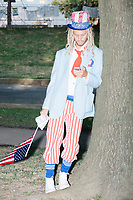 """Lukas Walsh, of Hartford, Conn., dressed as Uncle Sam in the protest area in FDR Park outside of the secure area surrounding the Democratic National Convention at the Wells Fargo Center in Philadelphia, Pennsylvania, on Wed., July 27, 2016. Walsh took a satirical approach to his protest, saying he was there """"to make sure big money stays in politics."""" He said he likes getting creative with activism. """"Being silly and doing shenanigans is a crucial component [to activism],"""" he said."""