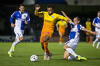 Mark McChrystal of Bristol Rovers slides in on Aaron Holloway of Wycombe Wanderers during the Johnstone's Paint Trophy match between Bristol Rovers and Wycombe Wanderers at the Memorial Stadium, Bristol, England on 6 October 2015. Photo by Andy Rowland.