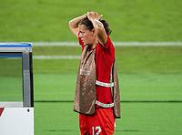 YOKOHAMA, JAPAN - AUGUST 6: Christine Sinclair #12 of Canada watches the game during a game between Canada and Sweden at International Stadium Yokohama on August 6, 2021 in Yokohama, Japan.