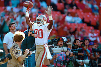 SAN FRANCISCO, CA - San Francisco 49ers Jerry Rice in action signaling for a touchdown catch during a game against the San Diego Chargers at Candlestick Park in San Francisco, California in 1991. Photo by Brad Mangin.