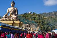 Thimphu, Bhutan.  Bhutanese Circumambulating the Great Buddha Dordenma Statue.  The Buddha sits in the Bhumisparsha gesture, calling the earth to witness.