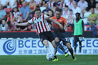 Sheffield United's John Lundstram vies for possession with Swansea City's Matthew Grimes during the Sky Bet Championship match between Sheffield United and Swansea City at Bramall Lane, Sheffield, England, UK. Saturday 04 August 2018