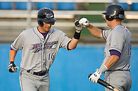 Lee Cruz #16 of the Winston-Salem Dash bumps fists with teammate Brent Morel #19 after hitting a home run in the first inning at Pfitzner Stadium June 11, 2009 in Woodbridge, Virginia. (Photo by Brian Westerholt / Four Seam Images)