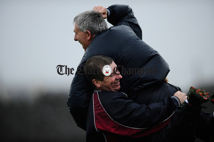 Liscannor manager Tommy Curtin celebrates with player John Torpey at the final whistle as his charges beat Doonbeg during their semi final at Miltown Malbay. Photograph by John Kelly.