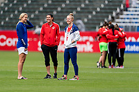 CARSON, CA - FEBRUARY 9: Lindsey Horan #9 of the United States talks with Christine Sinclair #12 of Canada and Becky Sauerbrun #4 of the United States during a game between Canada and USWNT at Dignity Health Sports Park on February 9, 2020 in Carson, California.
