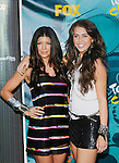 Fergie and Miley Cyrus at the 2009 Teen Choice Awards on August 9th,2009 at Gibson Amphitheatre in Universal City...Photo by Chris Walter/Photofeatures
