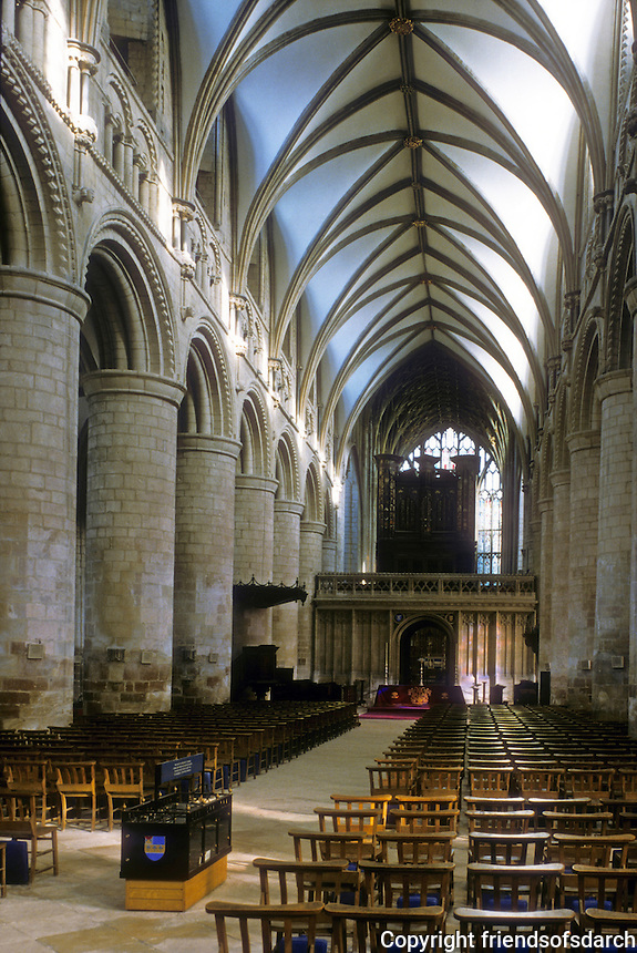 """Gloucester: Gloucester Cathedral--Nave. Romanesque piers, """"Early English"""" Gothic vaulting, ...1242."""