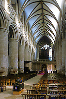 "Gloucester: Gloucester Cathedral--Nave. Romanesque piers, ""Early English"" Gothic vaulting, ...1242."