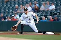 Charlotte Knights first baseman A.J. Reed (47) fields a low throw during the game against the Scranton/Wilkes-Barre RailRiders at BB&T BallPark on August 14, 2019 in Charlotte, North Carolina. The Knights defeated the RailRiders 13-12 in ten innings. (Brian Westerholt/Four Seam Images)
