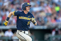 Michigan Wolverines first baseman Jimmy Kerr (15) runs to first base against the Vanderbilt Commodores during Game 3 of the NCAA College World Series Finals on June 26, 2019 at TD Ameritrade Park in Omaha, Nebraska. Vanderbilt defeated Michigan 8-2 to win the National Championship. (Andrew Woolley/Four Seam Images)