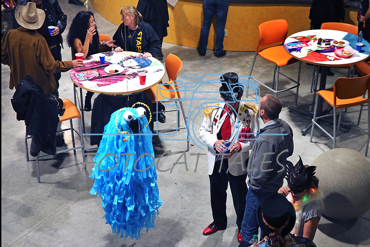 A piñata seems to join a conversation as dozens of artists from around the state of Nevada who performed or demonstrating their crafts at the annual Capital Collage in Carson City, Nev., on Friday, October 27, 2017. <br /> Photo by Lance Iversen/Nevada Momentum