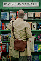 Tuesday 27 May 2014, Hay on Wye, UK<br /> Pictured: A man browses the Welsh Book selection at the Hay Festival <br /> Re: The Hay Festival, Hay on Wye, Powys, Wales UK.
