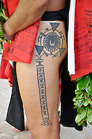 A Hawaiian man wearing a malo or loincloth sports a tattoo on his thigh.