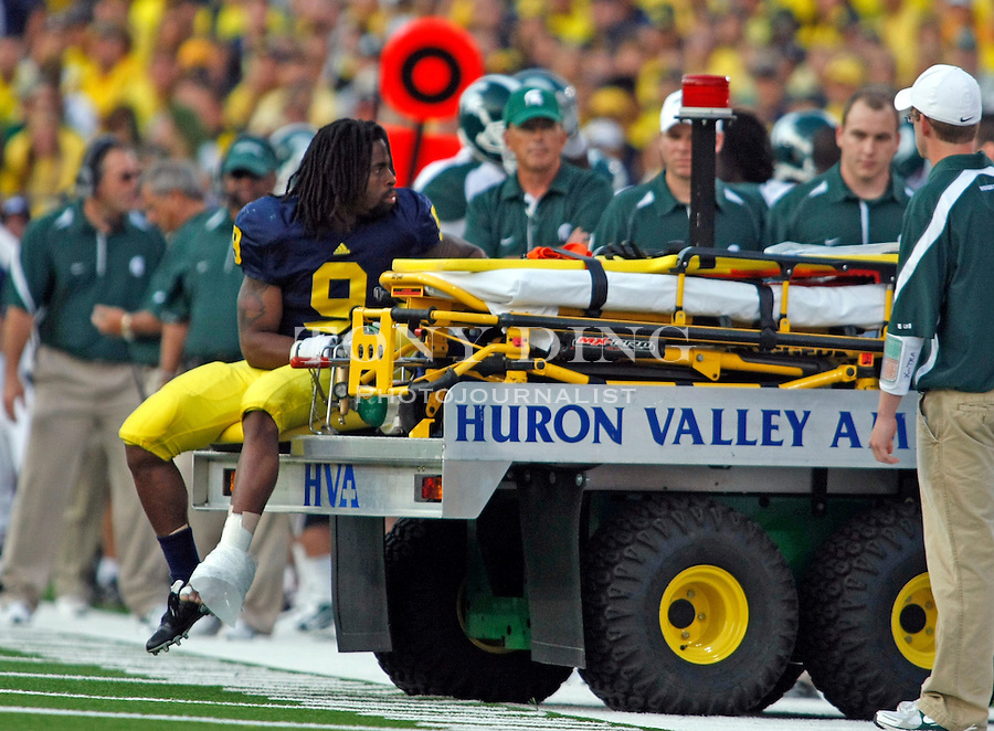 Michigan wide receiver Martavious Odoms (9) is carted off the field with a foot injury in the fourth quarter of an NCAA college football game with Michigan State, Saturday, Oct. 9, 2010, in Ann Arbor. Michigan State won 34-17. (AP Photo/Tony Ding)