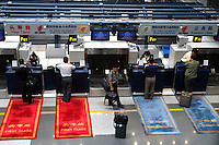 Passengers check in at the first & executive class check-in counter at Beijing International Airport. China 's biggest carrier by fleet size said it plans to raise 2.7 billion yuan (US$326 million) selling shares to domestic investors for the first time, raising money to buy Boeing Co. aircraft..07-JUL-03