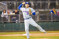 South Bend Cubs third baseman Jesse Hodges (25) makes a running throw to first base against the Lansing Lugnuts on May 12, 2016 at Cooley Law School Stadium in Lansing, Michigan. Lansing defeated South Bend 5-0. (Andrew Woolley/Four Seam Images)