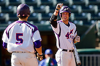 Kevin Kaczmarski (4) of the Evansville Purple Aces celebrates with Kyle Pollock (5) after he hit a home run during a game against the Indiana State Sycamores in the 2012 Missouri Valley Conference Championship Tournament at Hammons Field on May 23, 2012 in Springfield, Missouri. (David Welker/Four Seam Images)