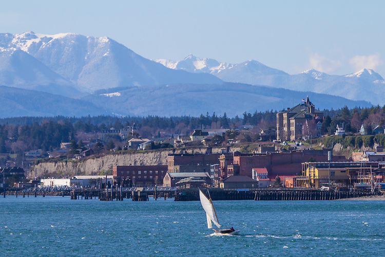 Port Townsend, waterfront, historic buildings, Olympic Mountains, winter sailing, gaff-rigged sloop,  Puget Sound, Olympic Peninsula, Washington State, Pacific nothwest, USA,