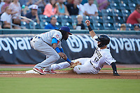 Danny Mendick (17) of the Charlotte Knights is tagged out by Buffalo Bisons third baseman Alen Hanson (31) at BB&T BallPark on July 24, 2019 in Charlotte, North Carolina. The Bisons defeated the Knights 8-4. (Brian Westerholt/Four Seam Images)
