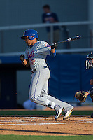 Yeffry De Aza (12) of the Kingsport Mets follows through on his swing against the Danville Braves at American Legion Post 325 Field on July 9, 2016 in Danville, Virginia.  The Mets defeated the Braves 10-8.  (Brian Westerholt/Four Seam Images)
