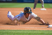 Grant Green (7) of the Salt Lake Bees slides head first into third base against the Albuquerque Isotopes at Smith's Ballpark on June 8, 2015 in Salt Lake City, Utah.  (Stephen Smith/Four Seam Images)