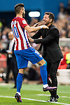 Yannick Ferreira Carrasco of Atletico de Madrid celebrates with coach Diego Simeone after scoring during their La Liga match between Atletico de Madrid and Granada CF at the Vicente Calderon Stadium on 15 October 2016 in Madrid, Spain. Photo by Diego Gonzalez Souto / Power Sport Images