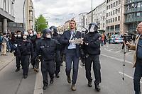 """Auf und rund um den Rosa-Luxemburg-Platz in Berlin-Mitte haben am Samstag den 25. April 2020 mehrere hundert Menschen gegen die Einschraenkungen im Zuge der Massnahmen zur Eindaeemung der Covid-19-Pandemie protestiert. Rechtsextremisten, Hooligans, Antisemiten, Verschwoerungstheoretiker und AfD-Politiker hatten zu einer sogenannten """"Hygiene-Demo"""" versammelt. Vereinzelt protestierten Menschen am Rande gegen diese Demonstration.<br /> Die Polizei war mit mehreren hundert Beamten im Einsatz und nahm mehr als 100 Personen fest.<br /> Im Bild: Polizeibeamte nehmen den als """"Volkslehrer"""" bekannt gewordenen Rechtsextremisten und vorbestraften Holocaustleugner Nikolai Nerling fest. <br /> 25.4.2020, Berlin<br /> Copyright: Christian-Ditsch.de<br /> [NUR FUER REDAKTIONELLE ZWECKE! Werbung nur auf Anfrage beim Fotografen. Inhaltsveraendernde Manipulation des Fotos nur nach ausdruecklicher Genehmigung des Fotografen. Vereinbarungen ueber Abtretung von Persoenlichkeitsrechten/Model Release der abgebildeten Person/Personen liegen nicht vor. NO MODEL RELEASE! Don't publish without copyright Christian-Ditsch.de, Veroeffentlichung nur mit Fotografennennung, sowie gegen Honorar, MwSt. und Beleg. Konto: I N G - D i B a, IBAN DE58500105175400192269, BIC INGDDEFFXXX, Kontakt: post@christian-ditsch.de<br /> Bei der Bearbeitung der Dateiinformationen darf die Urheberkennzeichnung in den EXIF- und  IPTC-Daten nicht entfernt werden, diese sind in digitalen Medien nach §95c UrhG rechtlich geschuetzt. Der Urhebervermerk wird gemaess §13 UrhG verlangt.]"""