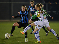 20131213 - VARSENARE , BELGIUM : Zwolle's Marianne Van Brummelen (right) pictured with Brugge's Jody Vangheluwe (left) during the female soccer match between Club Brugge Vrouwen and PEC Zwolle Ladies , of  matchday 14  in the BENELEAGUE competition. Friday 13th December 2013. PHOTO DAVID CATRY