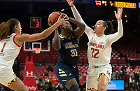 COLLEGE PARK, MD - NOVEMBER 20: Sara Vujacic #32 of Maryland defends against Mayowa Taiwo #31 of George Washington during a game between George Washington University and University of Maryland at Xfinity Center on November 20, 2019 in College Park, Maryland.