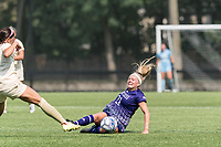 NEWTON, MA - SEPTEMBER 12: Melanie Lytle #21 of Holy Cross slides during a game between Holy Cross and Boston College at Newton Campus Soccer Field on September 12, 2021 in Newton, Massachusetts.