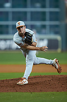 Texas Longhorns relief pitcher Dawson Merryman (42) follows through on his delivery against the LSU Tigers in game three of the 2020 Shriners Hospitals for Children College Classic at Minute Maid Park on February 28, 2020 in Houston, Texas. The Tigers defeated the Longhorns 4-3. (Brian Westerholt/Four Seam Images)