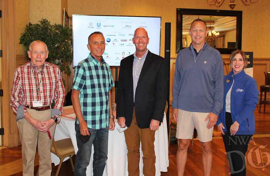 Ed Clifford, Jones Center CEO (from left); John George, center board member; Michael Samson, Jason Nichol, The Golf Event co-chab. irmen; and Kelly Kemp, director of advancement welcome golfers for the 14th annual benefit tournament Oct. 5 at Springdale Country Club.<br /> (NWA Democrat-Gazette/Carin Schoppmeyer)