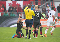 Toronto, Ontario - May 3, 2014: Toronto FC forward Gilberto #9 gestures to referee Mark Geiger during a game between the New England Revolution and Toronto FC at BMO Field.<br /> The New England Revolution won 2-1.