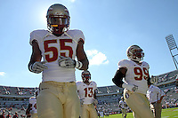 Oct 2, 2010; Charlottesville, VA, USA; Florida State Seminoles running back Ty Jones (33), DUPLICATE***Florida State Seminoles linebacker Nigel Bradham (13)***Florida State Seminoles wide receiver Rashad Gholston (13) and Florida State Seminoles defensive tackle Jacobbi McDaniel (99) walk on the field before the start of the game against the Virginia Cavaliers at Scott Stadium.  Mandatory Credit: Andrew Shurtleff-