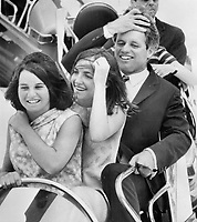 With two daughters, Senator Robert Kennedy gets look at Expo and hundreds of fair-goers took a look at them. Senator and Mrs. Kennedy and six children toured La Ronde area, and rode the Gyrotron.<br /> <br /> Photo : Boris Spremo - Toronto Star archives - AQP