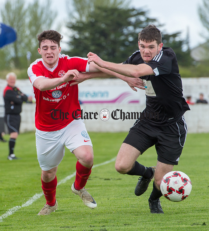 Ian Collins of Newmarket Celtic in action against Ryan Doherty of Janesboro during their Munster Junior Cup semi-final at Limerick. Photograph by John Kelly.