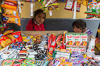 Peru, Cusco.  Mother and Daughter in their Streetside Snack Stand.