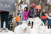 "People gather during the March For Our Lives protest and demonstration in Boston Common in Boston, Massachusetts, USA, on Sat., March 24, 2018. The march was held in response to recent school gun violence. Here, children hold signs reading, ""13 and afraid... not okay,"" ""Disarm hate,"" and ""Never again."""