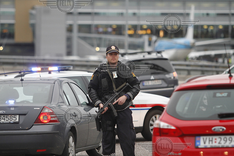 (Oslo July 22, 2011)A police  man a check point by Gardermoen Airport, north of Oslo. A large vehicle bomb was detonated near the offices of Norwegian Prime Minister Jens Stoltenberg on 22 July 2011. Although Stoltenberg was reportedly unharmed the blast resulted in several injuries and deaths. <br /> Another terrorist attack took place shortly afterwards, where a man killed over 80 children and youths attending a political camp at Utøya island. <br /> Anders Behring Breivik was arrested on the island and has admitted to carrying out both attacks.<br /> (photo:Fredrik Naumann/Felix Features)