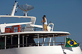 Manaus, Brazil. A couple dancing on the roof of the deck of a ship on the Amazon river.