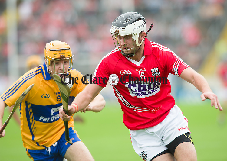 Jarlath Colleran of Clare in action against David Drake of Cork during their Intermediate hurling game at Thurles. Photograph by John Kelly.