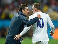 Wayne Rooney of England talks to Gary Neville