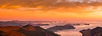 Sunrise over Cook Strait seen from highest peak in Marlborough Sounds, Mt. Stokes 1203m. D'Urville Island visible on horizon very left. Anakoha Bay at bottom right, Nelson Region, Marlborough, New Zealand