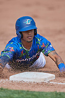 Jeremy Arocho (8) of the Ogden Raptors slides into third base against the Idaho Falls Chukars at Lindquist Field on July 29, 2018 in Ogden, Utah. The Raptors defeated the Chukars 20-19. (Stephen Smith/Four Seam Images)